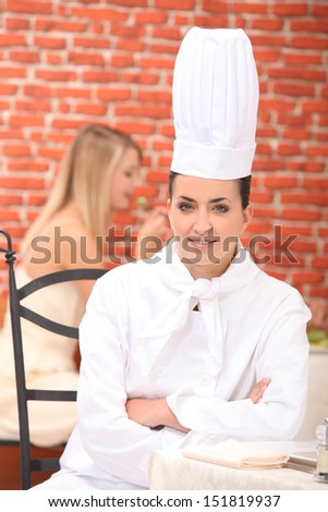 cook sitting in a restaurant - stock photo