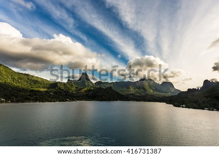 Cook the bay view from the deck of a cruise ship off the island of Moorea, French Polynesia. - stock photo