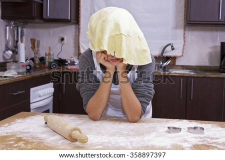cook with pizza dough dela - stock photo