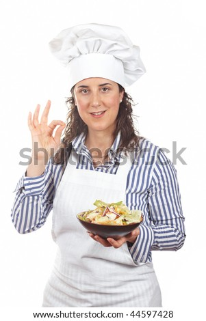 Cook woman and deliciousness gesture and holding a salad isolated on white background - stock photo