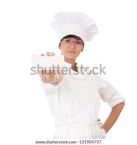 cook woman with empty card, focus on foreground, white background - stock photo