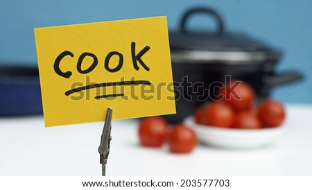 Cook written on a memo at the kitchen - stock photo