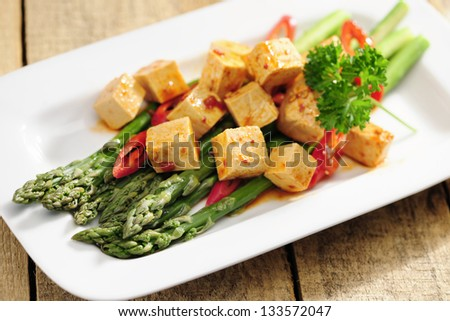 Cooked Asparagus and marinated Tofu, selective focus - stock photo
