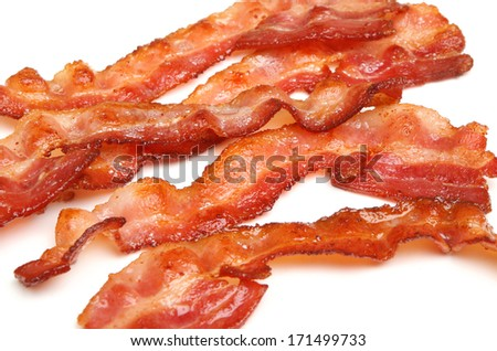 Cooked bacon strips on white background - stock photo