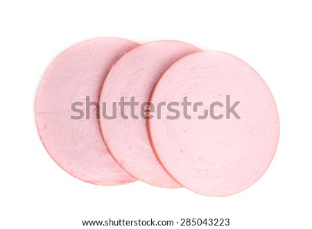 Cooked boiled ham sausage. Macro. Isolated on a white background. - stock photo