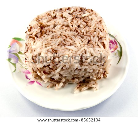 Cooked brown rice in dish. - stock photo