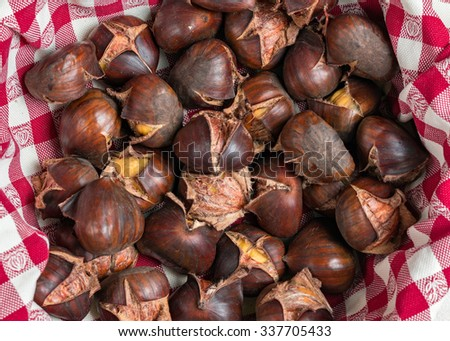 cooked chestnuts in a red cloth - stock photo