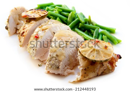 Cooked chicken breast with green beans isolated - stock photo