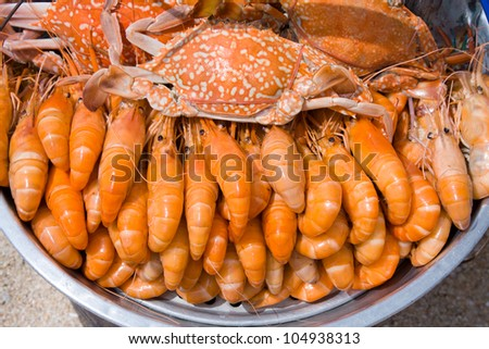 Cooked crabs and shrimps on the market of Thailand - stock photo