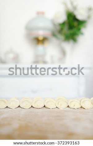 Cooked dumplings lie on the kitchen table. Close-up - stock photo