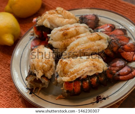 Cooked lobster tails on a plate - stock photo