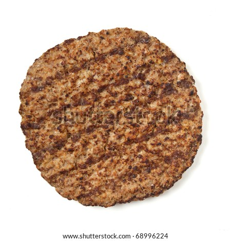 Cooked minced beef patty isolated on white background from overhead - stock photo