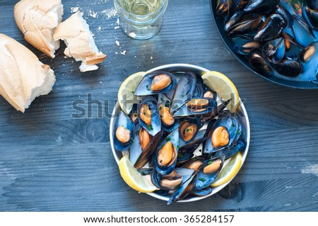 Cooked mussels marinara with tomato, garlic and olive oil, italy - stock photo