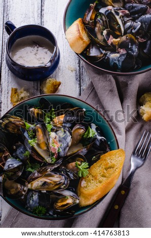 Cooked mussels with cream sauce, close up - stock photo