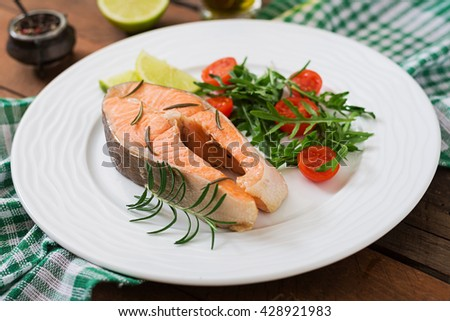 Cooked on steam salmon steak with vegetables. Dietary menu. Proper nutrition. - stock photo
