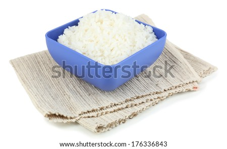 Cooked rice in bowl on napkin isolated on white - stock photo