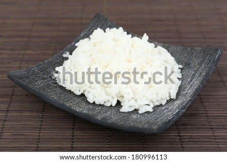 Cooked rice on bamboo background - stock photo