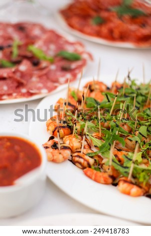 Cooked shrimps on toothpick - stock photo