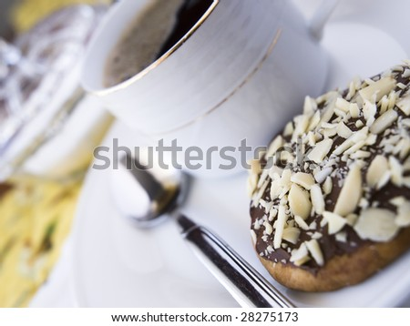 cookie and a coffee on a table - stock photo
