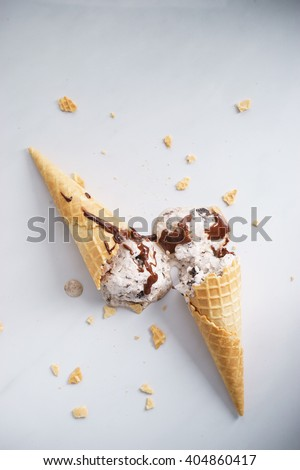 cookie and cream ice cream with waffle cone and chocolate - stock photo