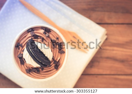 cookie cup cakes on wooden table - stock photo