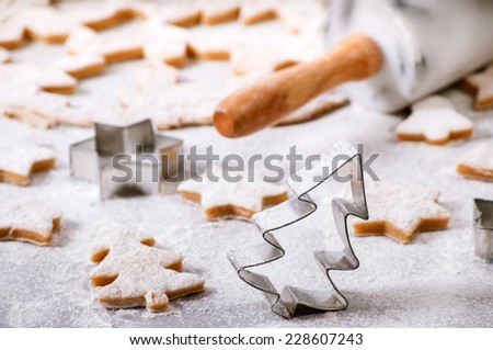Cookie cutters in the form of Christmas trees - stock photo