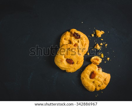 Cookie on black background, top view - stock photo