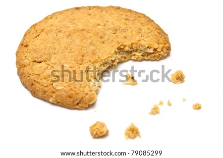 Cookie with crumbs side view isolated on white - stock photo