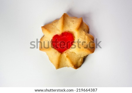 cookie with red cherry-heart - stock photo