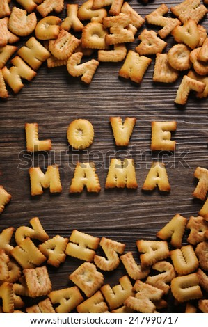 Cookies ABC in the form of word LOVE MAMA alphabet on old wood background, Valentines day - stock photo
