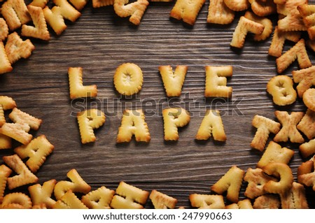 Cookies ABC in the form of word LOVE PAPA alphabet on old wood background, Valentines day - stock photo