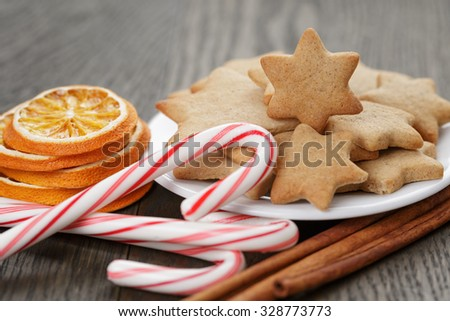 cookies, candy canes and spices for christmas, traditional decorations - stock photo