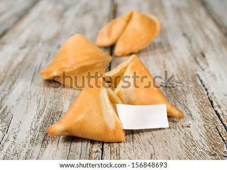cookies fate on a wooden background - stock photo