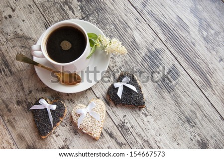 """Cookies for the wedding with a cup of coffee served with a golden spoon. From the series """"Wedding Cookies"""" - stock photo"""