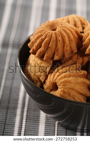 Cookies in black bowl - close-up - stock photo