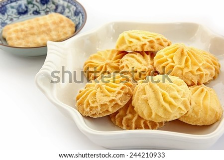 Cookies in dish on white background. - stock photo