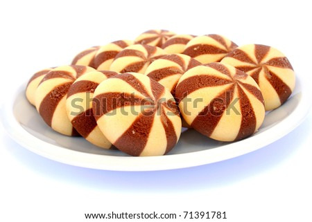 Cookies in plate isolated on white background. - stock photo