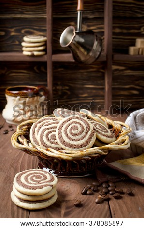 Cookies in the form of a spiral on a wooden table. Handmade biscuits - stock photo