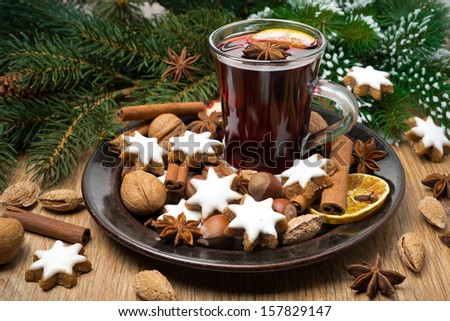 cookies in the shape of stars, spices and mulled wine on a plate, horizontal - stock photo