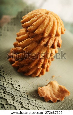 Cookies on green cloth - close-up - stock photo