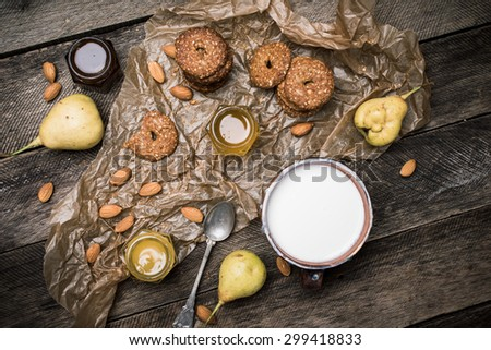 Cookies pears and yoghurt on wooden table. Rustic style and autumn food photo - stock photo