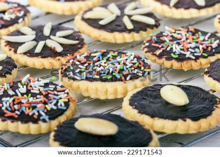 Cookies with chocolate, almonds and sprinkles/Biscuits/Cookies - stock photo