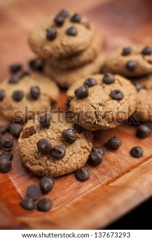 Cookies with chocolate chip on wooden tray - stock photo