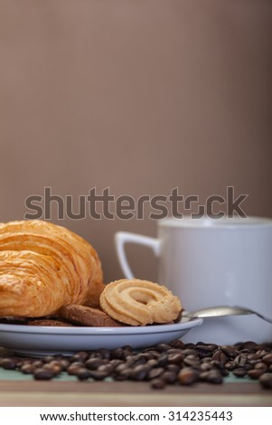 Cookies with coffee beans background - stock photo