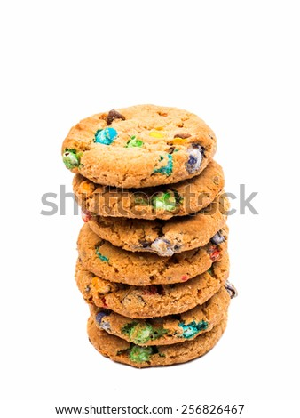 cookies with colored chocolate drops on a white background - stock photo