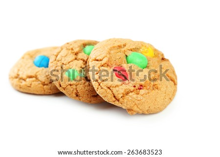 Cookies with colorful candy isolated on white - stock photo