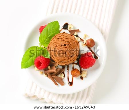 Cookies with hazelnuts, chocolate ice cream and raw raspberries - stock photo