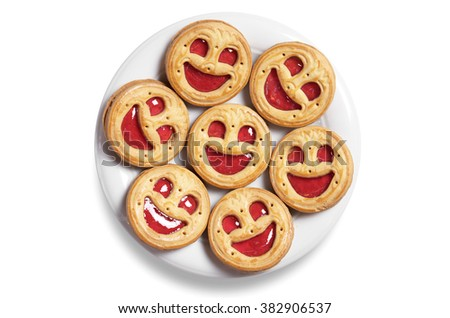Cookies with jam in plate on a white background, top view - stock photo