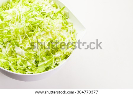 Cooking Background - Chopped cabbage in a bowl - stock photo