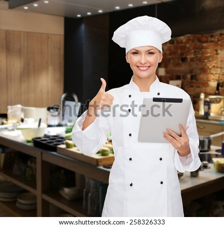 cooking, bakery, people, technology and food concept - smiling female chef cook or baker with tablet pc computer showing thumbs up over restaurant kitchen background - stock photo